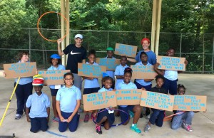 Addison Stapes and Jeffrey Weisberg with youth at Boulware Springs Charter School for Peace in Sports Tennis Program.