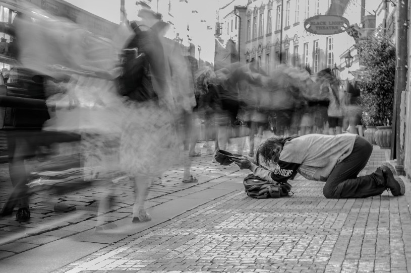 By just flowing in the stream of life, we may perpetuate wetiko behaviors where it's socially accepted to exclude and reject certain persons. A homeless beggar shows one of the faces of the social exclusion issue that is currently beating our society.
