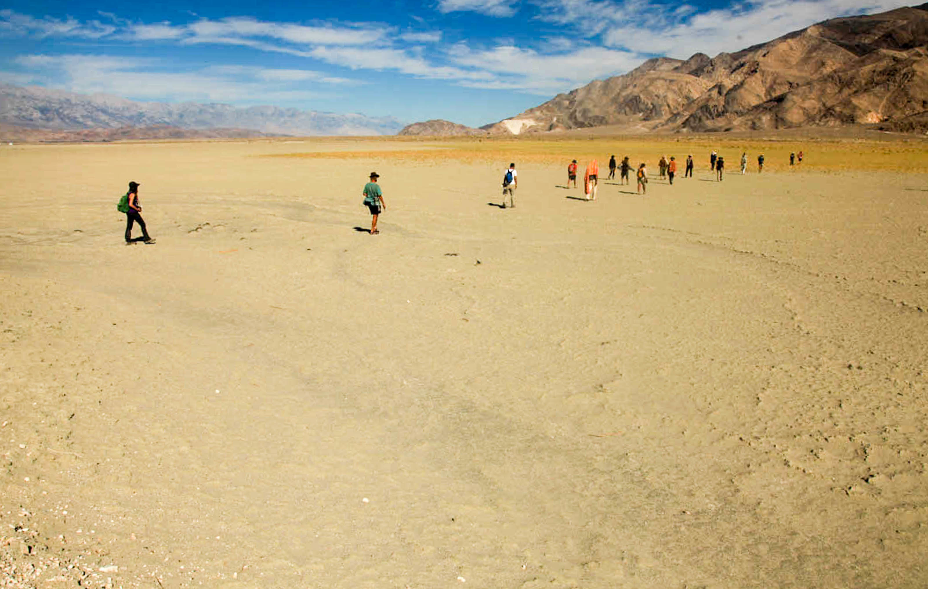 Walking Water pilgrims walking across a dry lake bed