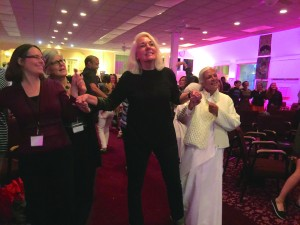 """Attendees dancing to """"How Can You Mend a Broken Heart,"""" a restorative narrative-based song at ivoh Summit 2015. photography 