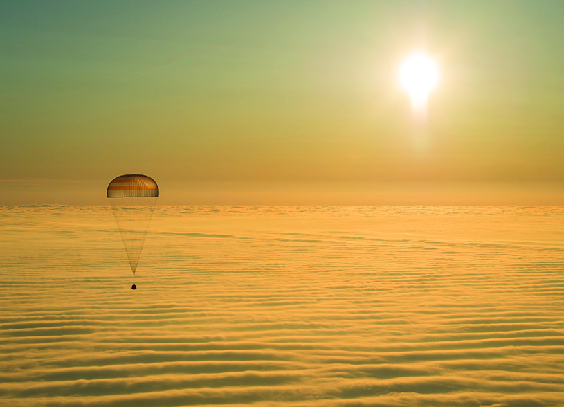 After six months in the International Space Station, members of Expedition 41 and 42 return to Earth by parachute in Kazakhstan.