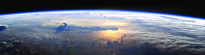 The Earth's atmosphere, seen from above. Gaia theory shows how life on Earth and the environment developed together as one co-evolutionary system. Without the presence of life, the Earth's atmosphere would be 98% carbon dioxide and the planet's surface temperature would be between 466 and 644 F.